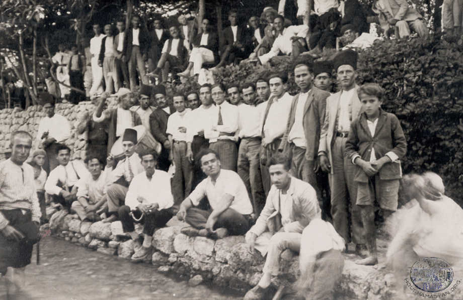 A group of men either at a Kheder Beg or Bitias restaurant